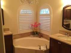 """Double trouble in the bath top plantation shutters"" Interior Shutters, Window Styles, Double Trouble, Design Your Own, Corner Bathtub, Regency, Window Treatments, Arch, Shades"