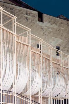 Wooden installation resembling ship sails