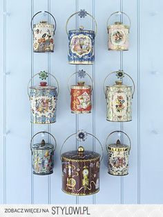 Blue Wall - Suspended from wooden pegs tipped with tin tiebacks is a bevy of covered tin pails from the and some lithographed with scenes or birds, a la hand-painted Continental porcelains, others with bouquets or all-over prints. Blue Rooms, Blue Walls, Tea Tins, Tea Canisters, Wooden Pegs, Displaying Collections, Vintage Tins, Vintage Vanity, Vintage Kitchen