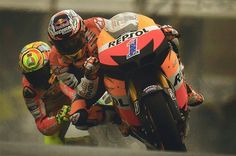 Moto GP - Stoner leading Rossi How low can you go in the wet?