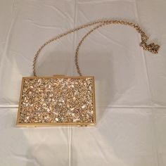 Gold Clutch Gold clutch! Has a gold chain that can be tucked inside if you don't want it! RSVP Bags Clutches & Wristlets