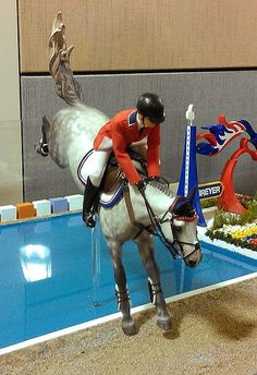 Glory and Jake in show jumping over the water jump