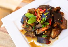 This vegan-friendly eggplant stir-fry is spicy, delicious, and simple to make! It works with any type of eggplant and you can adjust the spice level. Eggplant Stir Fry, Spicy Eggplant, Eggplant Recipes, Baby Eggplant, Vegetable Recipes, Vegetarian Recipes, Cooking Recipes, Healthy Recipes, Side Recipes