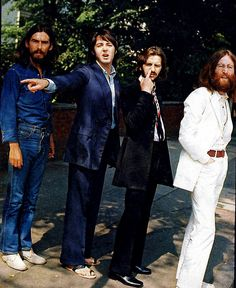 <b>Here are some awesome candid photos from the day of the photo shoot for the Abbey Road album cover.</b> Is that Ringo picking his nose?