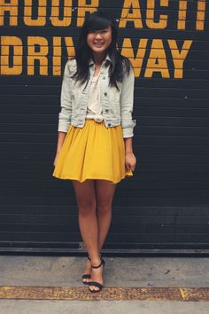 graphic tee, denim jacket, bright skirt