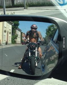 Is it just me or is that naked biker giving me the finger wearing actually f*cking flipflops?