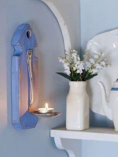 A piece of wood, a bent spoon and a tea candle are all you need to create your own light fixture.  Decor - Woman's Day