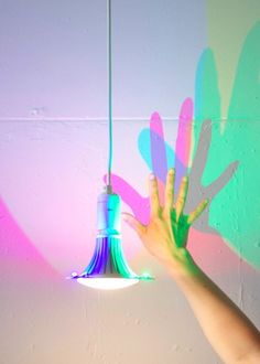 I NEED this in my life! CMYK Lightbulb That Casts Colored Shadows - DesignTAXI.com
