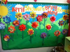 April through May Bulletin Board. Th flower shape and stem were cut out by my preschoolers and the flower was made by coloring two coffee filters and spraying them with water.