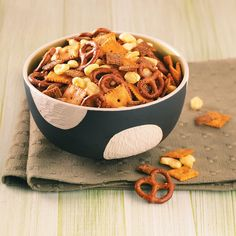 Sweet 'n' Spicy Snack Mix Recipe -This yummy snack mix was concocted by our Test Kitchen. Chex cereal, cheesy snack crackers and mini pretzels are baked with a sprinkling of soy sauce, chili powder and barbecue seasoning. The mix is sure to spice up your next party or festive gathering. —Taste of Home Test Kitchen, Milwaukee, Wisconsin
