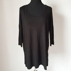 """▪️SALE▪️Side Slit Tunic Top Side Slit Tunic in luxe jersey fabric in black.  Easy rounded neckline and dropped shoulders give this top a laid back boho vibe.  NWT, never worn!  Boutique brand.  ▪️️SALE! $39 marked down to $29!▪️  Measurements laying flat: Armpit to armpit: 23.5"""" Waist (across): 21.5"""" Total length: 27"""" Sleeve length: 17"""" (approx.) Charm City Tops Tunics"""