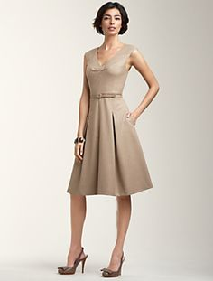 I want this dress.  I looks classy with clean figure flattering lines.  I may buy it, but (sigh) I don't need it.