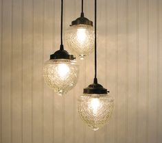 this is awesome and love the play on the old fashion look.  the grouping is unusual for this style but is great, it's surprising more folks dont group solitary lights and instead go for typical chandeliers.  this makes much more of a statement then any faux crystal studded lightpiece.