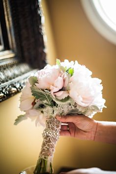 Wrapping lace around your bouquet is so different and so dazzling // Photo by Bill Waldorf  #wedding #weddingflowers #weddingbouquets #castletonfarms