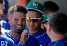 ROYALS CELEBRATE: Kansas City Royals shortstop Humberto Arteaga, left, smiles as he celebrates his run scored against the Milwaukee Brewers during the first inning March 17, 2017, in Phoenix. The Royals won 8-5.