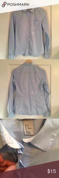 Button Down Dress Shirt Lightweight pale blue button down blouse. Nice darts and tailoring for curves, single front pocket, white inside cuffs is cute rolled over sweater sleeves. Cotton/poly/elastane blend has a little give but feels crisp. Spots are from a crystal in my window :-). Rarely worn, perfect condition, EUC! H&M Tops Button Down Shirts