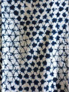 "These two are shibori dyed.  The one shown here, above and below, is a subtle and complex pattern of stacked diamonds.  It seems that the paler, more ""spider web"" diamonds were tied and then bound with string while the darker diamonds were tied and not bound.  Binding and not binding give two different effects which was used to great artistic advantage here."