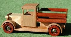 Well, they say that most woodworking involves making boxes. As I have always loved vintage cars, but alas, cannot afford to purchase or restore one, I made these from wood. These are little boxes on wheels. The toy truck is a model of . Wooden Toy Trucks, Wooden Car, Kinetic Toys, Making Wooden Toys, Wood Toys Plans, Small Wooden Boxes, Woodworking Workshop, Little Boxes, Old Toys