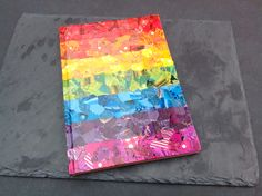 I decopatched the cover of this notebook in rainbow colours.