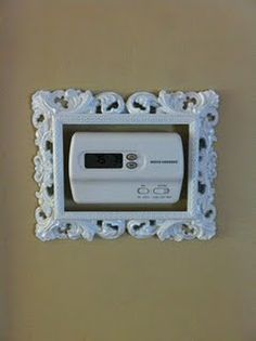 What a cute way to enhance an ugly thermostat! Love this