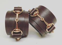 Joxasa horsebit leather cuffs.