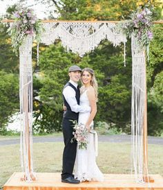 33 Boho Wedding Arches, Altars And Backdrops To Rock: a wedding arch covered with macrame and pastel flowers