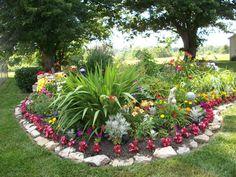 Hate the border, but like the big focal point greenery - Flower Garden Landscaping Flower Landscape, Landscape Design, Garden Design, Most Beautiful Gardens, Beautiful Flowers Garden, Simply Beautiful, Garden Features, Colorful Garden, Tropical Garden