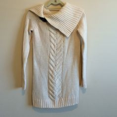 Moda Cream Sweater Cream sweater. Brown faux leather buckle at neck line. Super cute with leggings. 70% acrylic 30% wool. Perfect condition. Moda International Sweaters Cowl & Turtlenecks