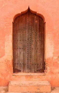 Peach and Brown Door and Entrance in Marrakech, Morocco Cool Doors, Unique Doors, Portal, When One Door Closes, Door Detail, Knobs And Knockers, Terracota, Grand Entrance, Closed Doors