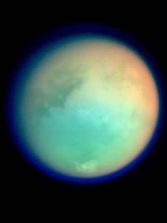 Saturn's moon Titan is the only moon we know of with its own atmosphere. In fact, the atmosphere is so thick that we had no idea what the surface was made of until we sent a probe in 2005.
