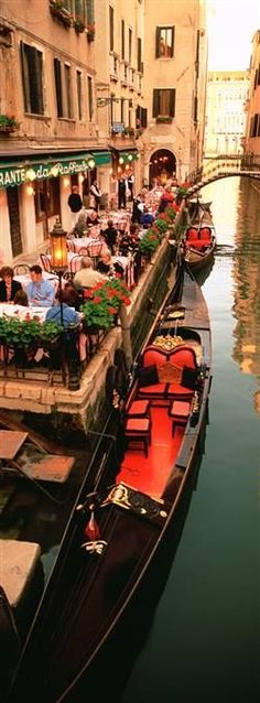 Gondolas alongside a cafe in Venice, Italy.