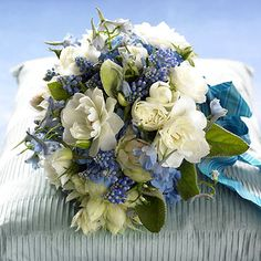 I love this wedding bouquet filled with white garden roses and pretty blues