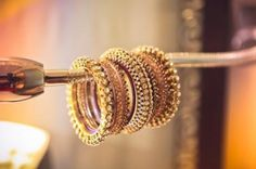 Indian Wedding Jewelry - Gold bangles for the classic bride | Find more wedding jewellery inspiration on www.wedmegood.com | WedMeGood #indianbride #indianjewellery #wedmegood #jewelry