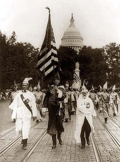 ~A Embarssing Piece of History~ Leading the Ku Klux Klan parade which was held in Washington, D.C. today; on the right is Mr. J.M. Fraser ... from Houston, Texas. It was taken in 1926.