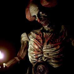 (Game) Resident Evil 7 - I like this character because it looks like a clown doll that is decaying; it's clearly old which means it fits well in the subterranean setting for my Begin game because my audience needs to feel that the subterranean environment has been abandoned and decaying for years.