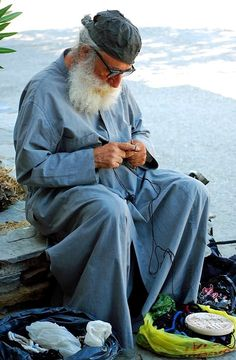 A monk knotting komboskini (orthodox prayer rope), Mount Athos, Greece | by Michael T.