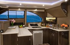Carver C34: We like the U-shaped design of the galley as it keeps the cook out of the flow of the boat. Note the amount of counter space. Microwave, two-burner stove top and a refrigerator are standard.