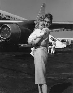 Audrey Hepburn Holding Baby Son Sean Near Airplane