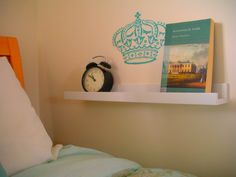 "Ikea Ribba picture ledge in the bedroom as a ""sidetable"" when the bed is against the wall.   via la vie DIY"