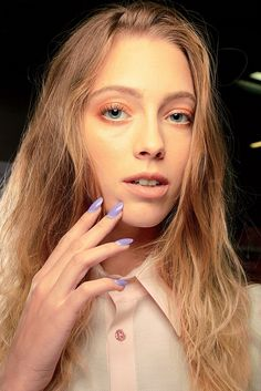 Bright purple mani and coral eyeshadow? We say go for it.