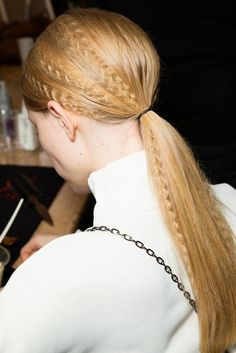 Yes, the 80's crimped hair is a comeback for the Stella McCartney runway shows. Pros put a textural twist on the classic ponytail, which gave the models a cool abstract look. Yeseily P.