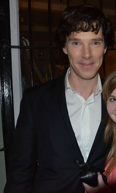 Benedict as Sherlock on the way for playing season 3, 4/02/2013, with a fan who was lucky enough to speak to him, be hugged and have a photo with him...