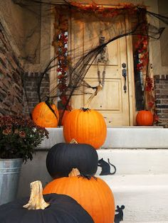orange and black pumpkins with cute little mice for steps on porch