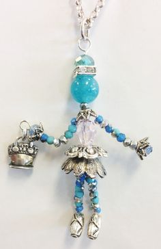 "LITTLE SIDEKICKS   HANDCRAFTED BY CJ STUDIO - ""MEGHAN"" Little Sidekicks are tiny, whimsical, collectable, jewelry people (Bead People). Each one is unique, and they have moveable parts. Little Sidekicks can be worn as a pendant on a chain or can have a clip added to use on a handbag or clipped onto a collar. Sidekicks make a great unique gift and can be made to order with personalized colors and charms. Available at: http://www.littlesidekicks.com"