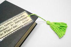 Papier-Upcycling - Experimentieren mit Alt- und Abfallpapier, sowie mit ausrangierten BüchernGirlande - Material - Papier, Wolle, Garn, selbstklebende Foli - Werkzeug: Schere - Technik: Bildtransfer mit Klebefolie, schneiden, kleben, wickeln