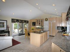 Vaulted Open Floorplan Kitchen with Mirrored Backsplash on Bulter Bar, custom cabinets, granite counters, lots of windows and custom window treatments  in Martha May's BHHS KoenigRubloff Realty Group Glenview, IL  Listing