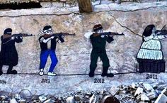 In the Damascus suburb of Darayya, graffiti on a destroyed building examines how the civil war has evolved over time. Image Source: reddit