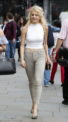 Chic as ever: Pixie's beige skinny jeans were cropped at the ankle, highlighting her toned physique in the dressed down ensemble