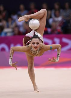 Anna Alyabyeva of Kazakhstan performs with the ball during the Rhythmic Gymnastics qualification on Day 13 of the London 2012 Olympics Games.