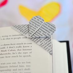 This is another heart tutorial.  Is the 'book page' trend over yet?  I sure hope not, because I just love the look of this corner bookmark...